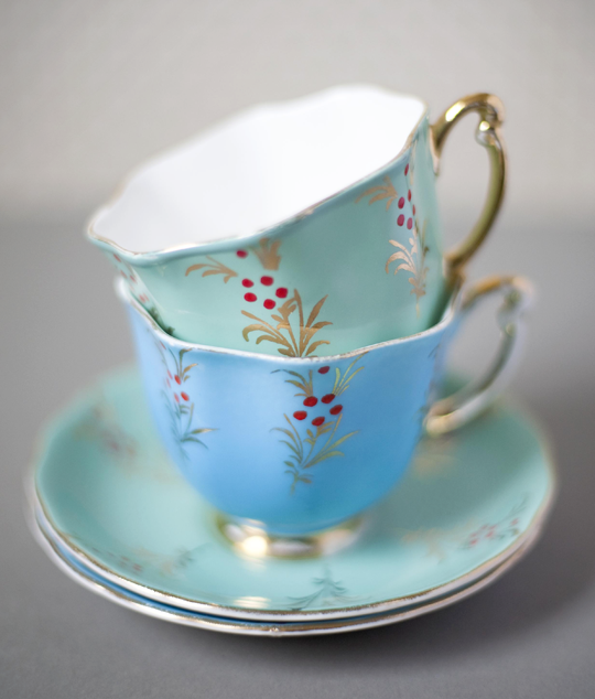 blue and green teacups