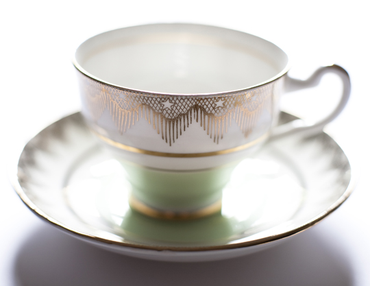 green and gold teacup