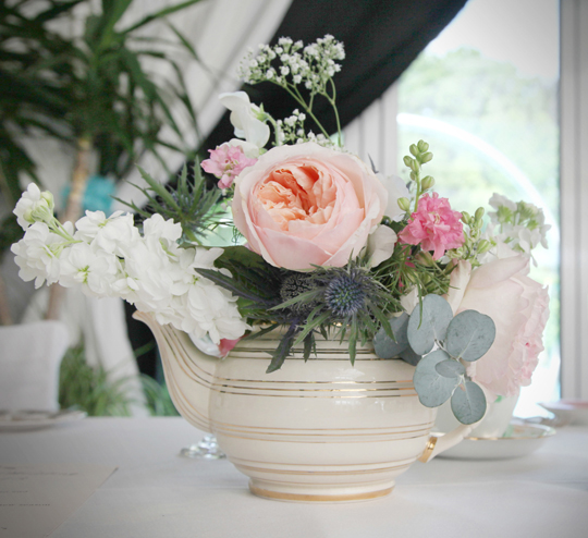 Teapot filled with flowers