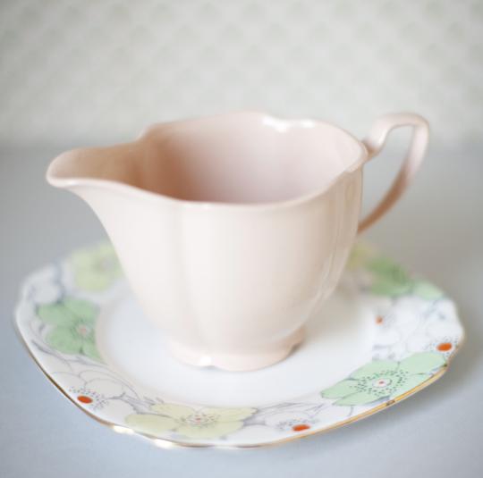 pink milk jug and floral plate