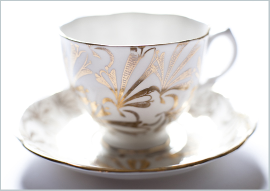 white and gold teacup